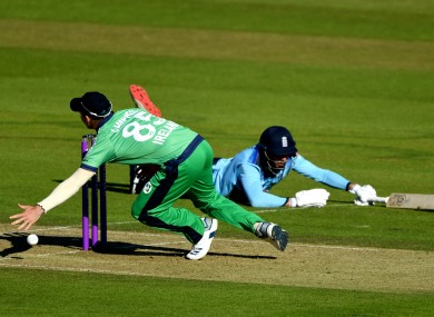 England's James Vince dives to make his ground as Ireland's Curtis Campher (left) attempts to catch the ball.