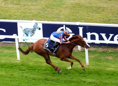 Moore crossed the line on Love nine lengths clear of the field.