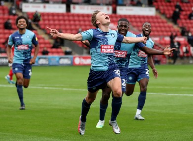 One foot in the final: Alex Samuel leads the Wycombe celebrations.