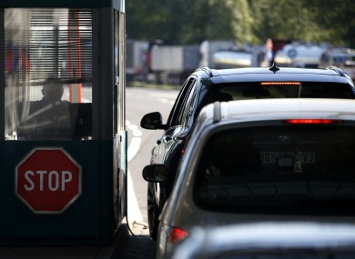 People in cars wait at the Horgos border crossing into Hungary from Serbia.