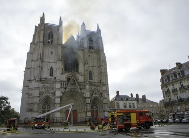 Firefighters working to extinguish the blaze at the Gothic St Peter and St. Paul Cathedral in Nantes, western France