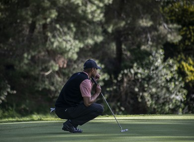 Tiger Woods reading the green during Round 1 of the PGA Tour Genesis Invitational back in February.