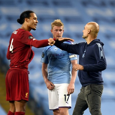 Guardiola with Virgil Van Dijk as Kevin de Bruyne watches on.