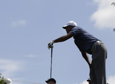 Woods winces as he watches his shot in the second round of the Memorial tournament.