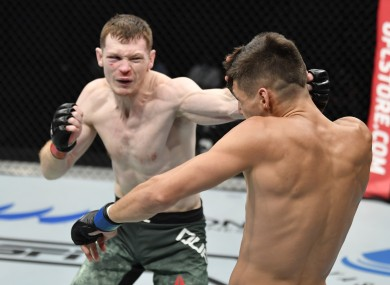 Joseph Duffy (left) suffered a first-round submission defeat to Joel Alvarez in Abu Dhabi overnight.