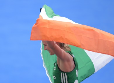 Flying the flag: Daly celebrates Ireland's World Cup quarter-final win.