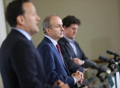 Taoiseach Micheál Martin, flanked by Tánaiste Leo Varadkar and Minister for Climate Action Eamon Ryan.