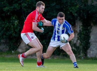 Ballyboden's Ross McGarry is tackled by Jack McCaffrey of Clontarf.
