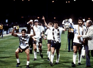 Tony Galvin (third l) celebrates with Ricky Villa (third r) as Spurs lift the Cup.