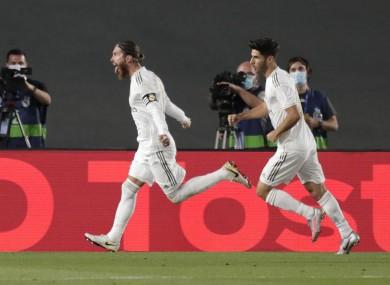 Sergio Ramos celebrates scoring the all-important goal.