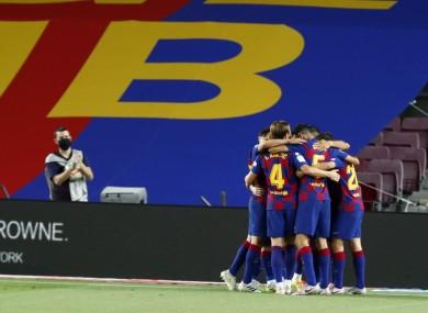 Barcelona's Luis Suarez celebrates with team-mates.