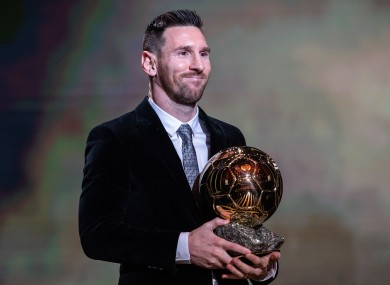 Lionel Messi with last year's Ballon D'Or award.