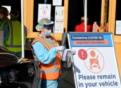 Australian health workers administering Covid-19 tests to people in their cars at a testing centre in Sydney today.
