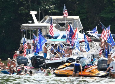 Trump supporters gather at a lake in Tennessee, where cases have risen to over 50,000