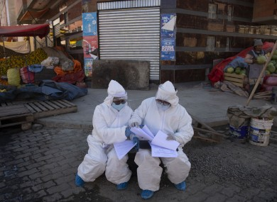 Healthcare workers dressed in full protective gear in Bolivia