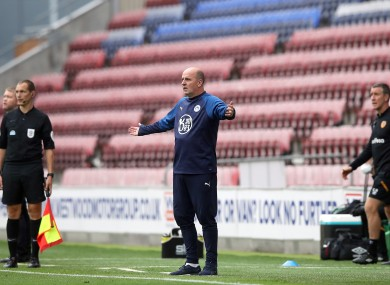 Cook on the touchline during Wigan's meeting with Hull earlier this month.