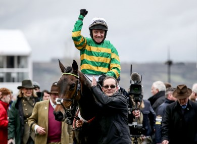 Barry Geraghty celebrates after winning the 2020 Champion Hurdle with Epatante.