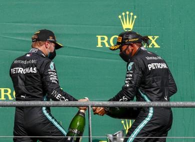 Lewis Hamilton celebrates on the podium with second-placed Mercedes driver Valtteri Bottas.