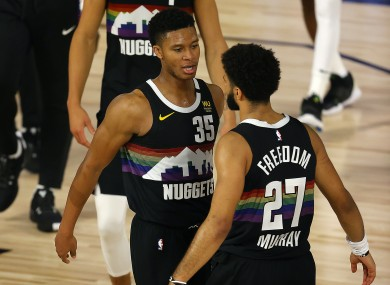 Jamal Murray (right) and team-mate PJ Dozier celebrate the Denver Nuggets' stirring come-from-behind win which kept their post-season alive against the Utah Jazz.
