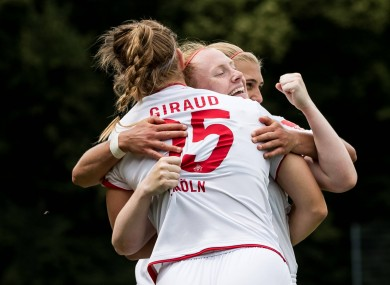 Barrett, centre, celebrates her winning goal against SC Sand - but it wasn't enough to save Köln from relegation.