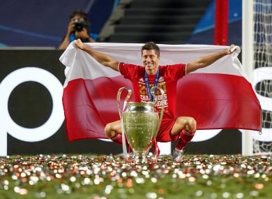 Robert Lewandowski celebrates with the Champions League trophy.