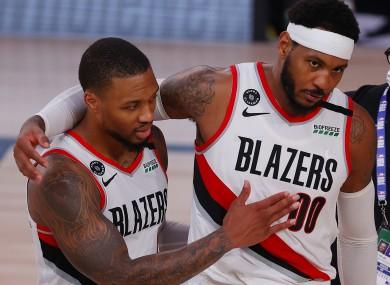 Carmelo Anthony and Damian Lillard  of the Portland Trail Blazers celebrate a win against the Philadelphia 76ers.