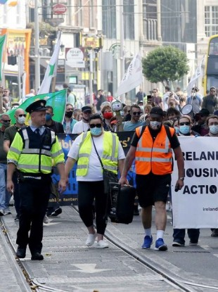 Protesters march in Dublin against the housing crisis on 15 August.