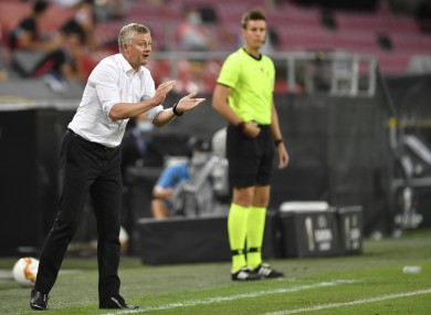 Manchester United manager Ole Gunnar Solskjaer gestures on the touchline during the game against Sevilla.