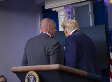 Trump was escorted from the room by a Secret Service agent.