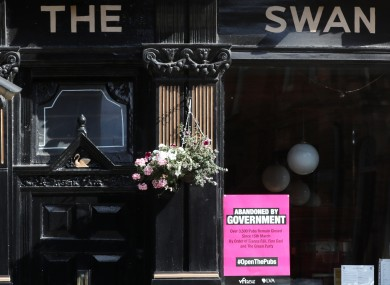 The Swan pub in Dublin city with an 'abandoned by government' poster outside it.