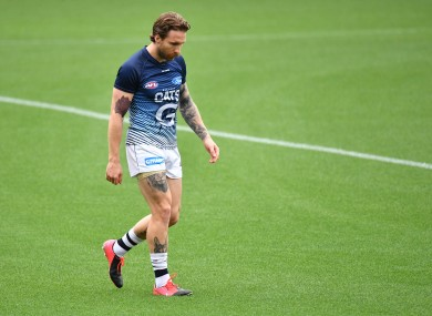 Tuohy walks out of Geelong's warm-up ahead of the match against Essendon.