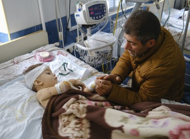 A man with his child, who was wounded during shelling, in Stepanakert, Nagorno-Karabakh, yesterday.