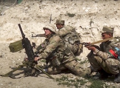 Azerbaijan's soldiers fire from a mortar at the contact line of the self-proclaimed Republic of Nagorno-Karabakh, Azerbaijan.
