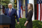 Judge Amy Coney Barrett reacts as US President Donald Trump introduces her as his the Supreme Court Associate Justice nominee