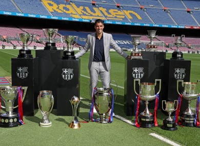 Suarez parades the trophies he won at Barca on his last day at Camp Nou.