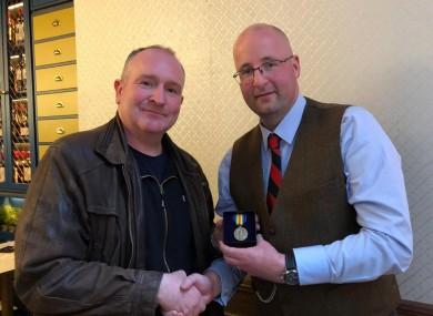 Gerard 'Del' Delaney presenting James Murray's victory medal to James's great grandson Dr John Murray