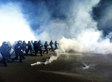 Police use chemical irritants and crowd control munitions to disperse protesters during a demonstration in Portland, Oregon