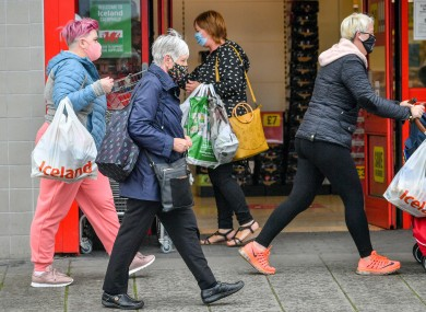 File image of people wearing face coverings in the UK.