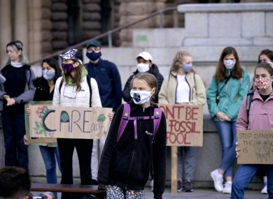 Swedish climate activist Greta Thunberg and others protest in front of the Swedish Parliament