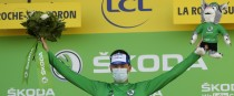 Ireland's Sam Bennett, wearing the best sprinter's green jersey, celebrates on the podium.