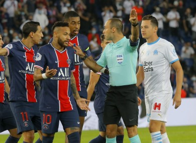 Neymar and team-mates argue with referee Jerome Brisard.
