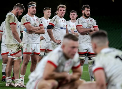 Ulster players stand by post-match. In the foreground, Ian Madigan consoles James Hume.