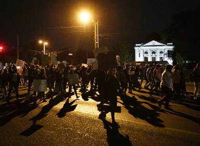 Protesters march on Gallatin Ave past the East Nashville Library on the way downtown in Nashville
