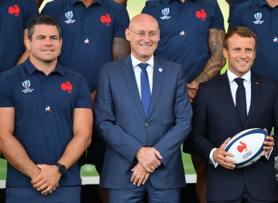 Laporte (centre) alongside Emmanuel Macron (right).