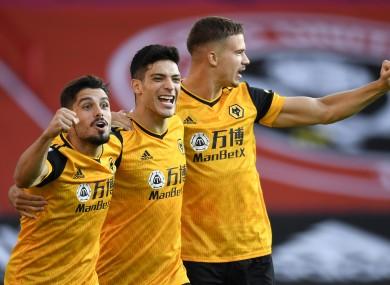 Wolverhampton Wanderers' Raul Jimenez (centre) celebrates with team-mates Pedro Neto (left) and Leander Dendoncker.