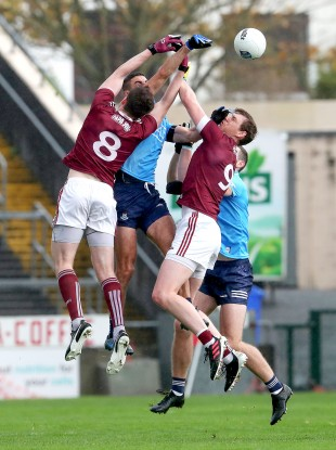 Cein D'Arcy and Tom Flynn compete against James McCarthy and Brian Fenton.