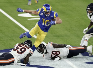 Rams wide receiver Cooper Kupp, top, leaps over Bears inside linebacker Danny Trevathan (59).