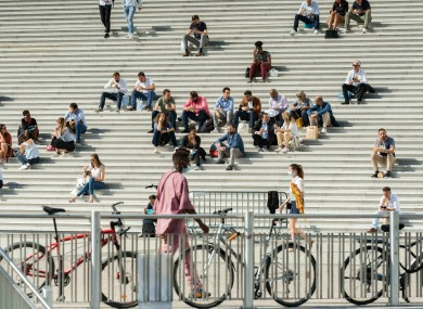 People on the steps of La Grande Arche in France last month.