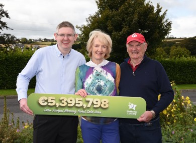 John DeLoughry, owner of DeLoughry's Gala service station at Talbot's Inch Co Kilkenny celebrating with his parents, Anne and Jack after selling the winning Lotto ticket.