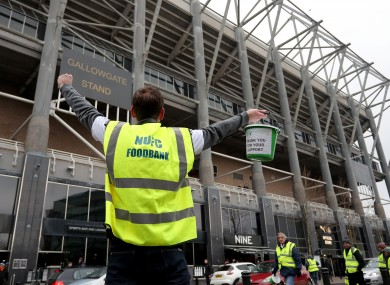 A file photo, dated January 2019, of a Newcastle fan raising money for a local foodbank.